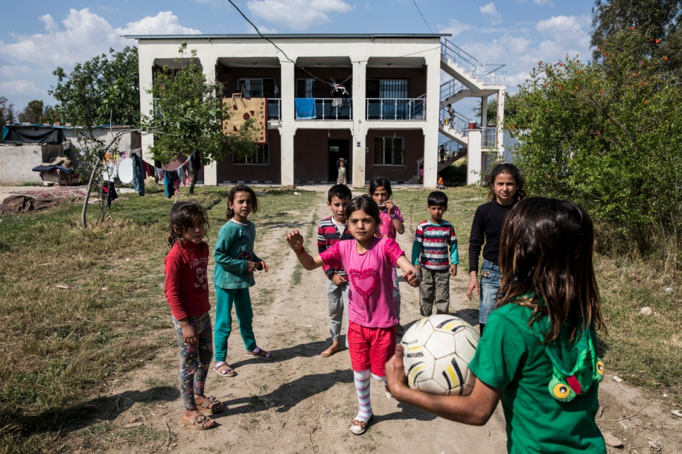 Young Syrian refugees play outside their accommodation provided by Levent Topçu, in Torbali, Turkey.