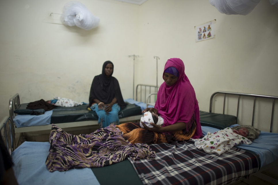 A Somali refugee rests after having just given birth to twins in one of Dadaab refugee camp's hospitals.