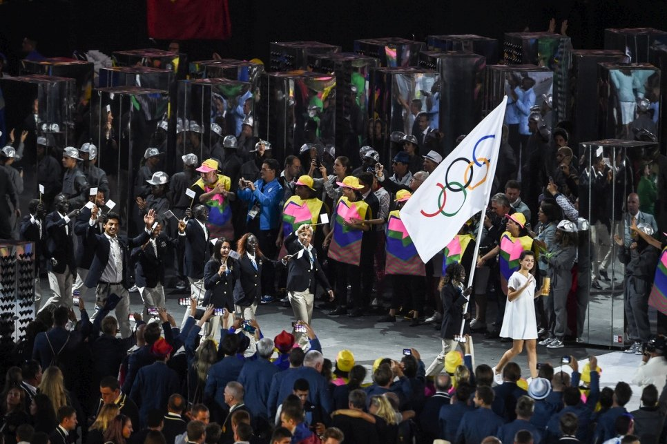 Rose Lokonyen carries the Olympic flag and leads the Refugee Olympic Team during the Opening Ceremony of the 2016 Games in Rio.