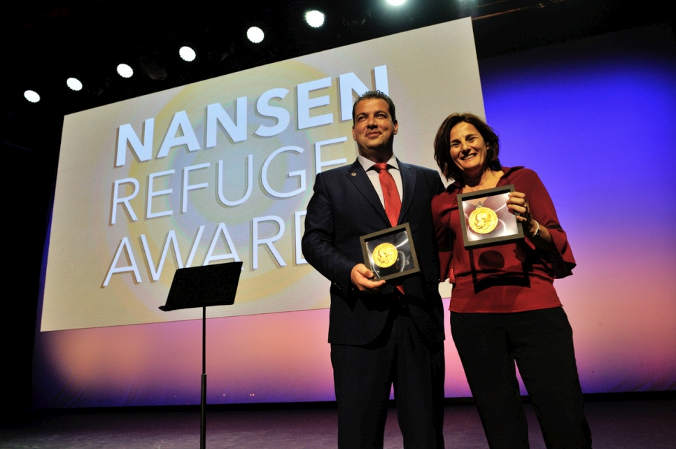 Joint winners the Hellenic Rescue Team and Efi Latsoudi of PIKPA village on Lesvos hold the humanitarian awards they received at a ceremony in Geneva.