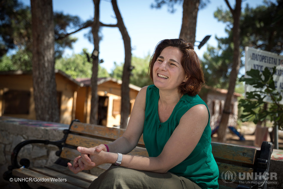 "2016 - Efi Latsoudi plays is pictured at ""PIKPA village"" on the Greek island of Lesvos. Latsoudi is a human rights activist behind PIKPA, where vulnerable refugees such as children, pregnant women and the disabled have been finding sanctuary since 2012."