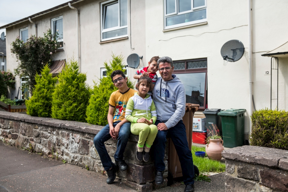 Mohammad Murad (left), 12, pictured with his sister Aisha, 10, brother Oweis, 4, and father Mohammed, 38, at their new home in Edinburgh.