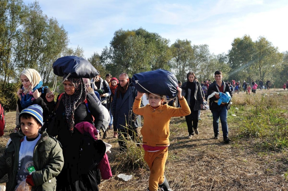 Refugees and migrants walk through a field in Slovenia after after crossing the border from Croatia in this 2015 file photo.