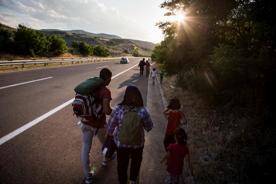 A Syrian refugee family walk along the main highway, near Veles, Macedonia. Hundreds of refugees and migrants are traveling through Macedonia everyday on their way north through the Balkans, in an attempt to reach western Europe. They use whatever means of transport is available including trains and bicycles, however many end up walking the entire distance.