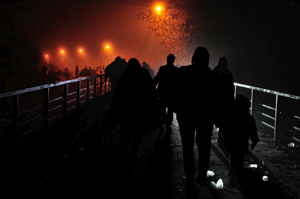 Croatia. Refugees walking over a bridge to the Slovenian border close to midnight