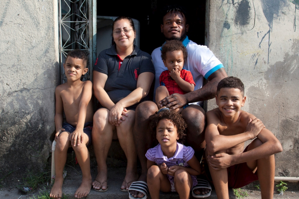 Brazil. A Congolese Olympic judoka and his family outside their home in Rio de Janeiro