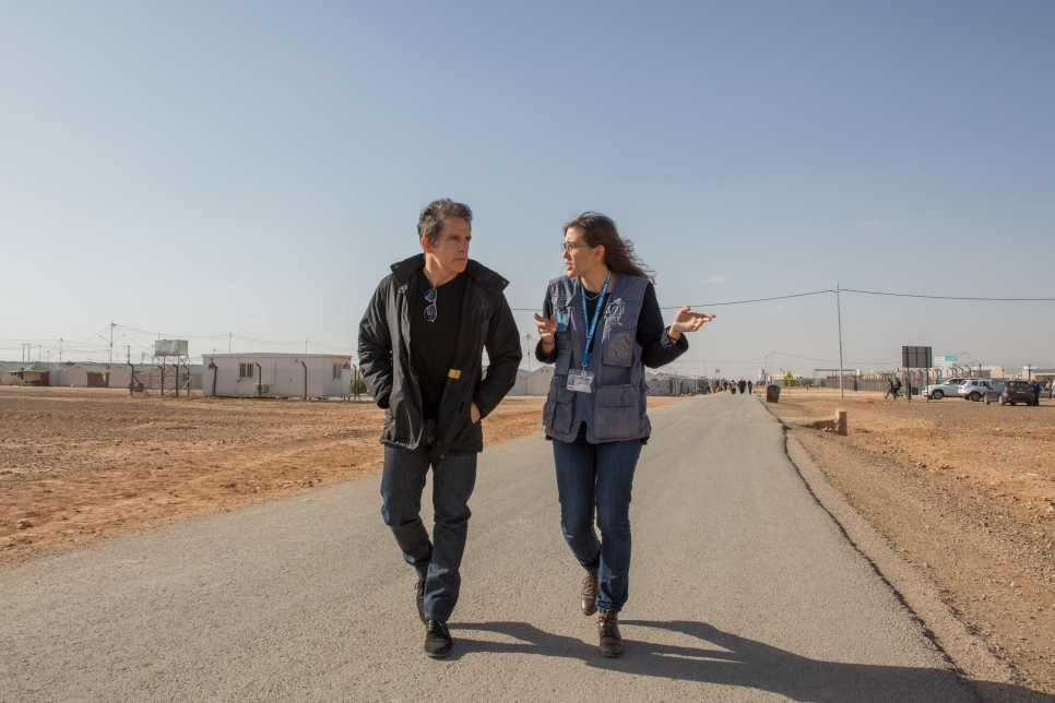 Ben is guided through Azraq refugee camp by a UNHCR staff member. The camp is home to some 35,000 Syrian refugees.