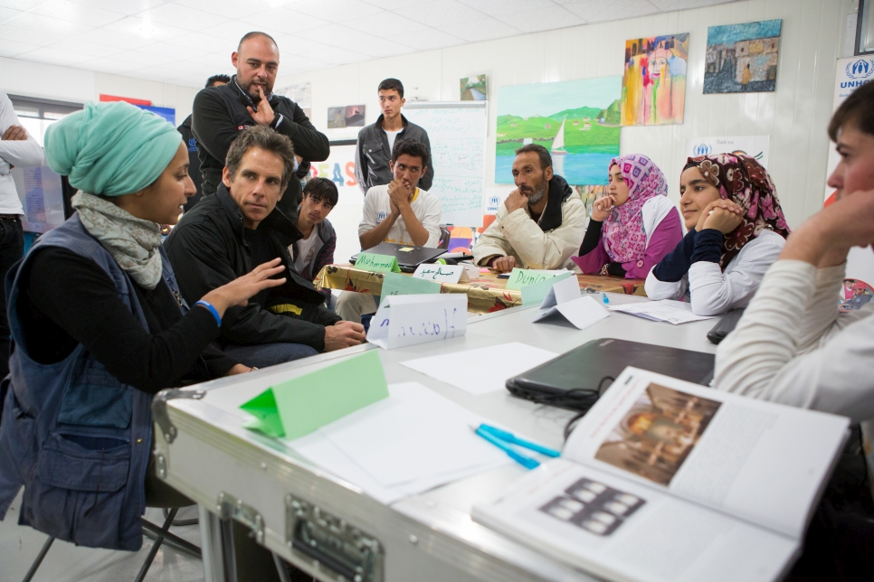 Ben speaks with refugees at the UNHCR-funded community center in Azraq refugee camp.