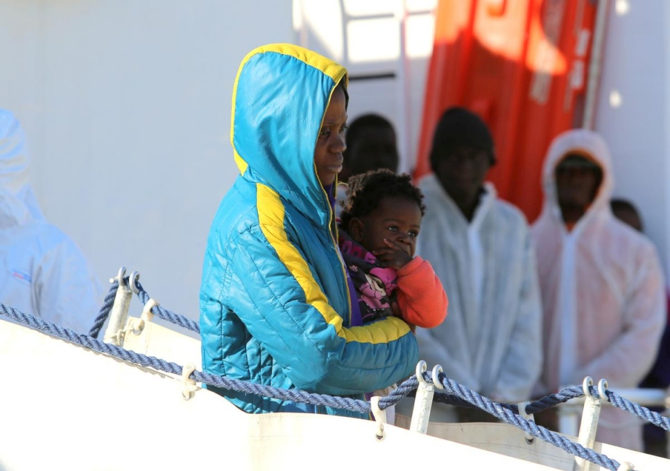 Italy. Migrants and refugees aboard the Italian Coast Guard vessel 'Corsi' arriving at the port of Augusta