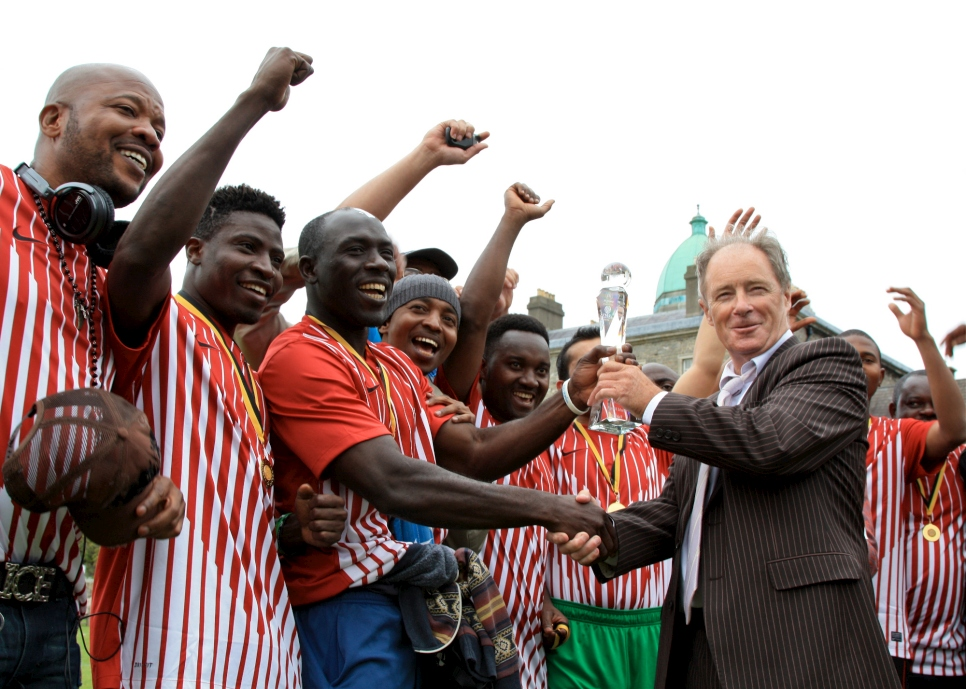 Former Republic of Ireland football manager, Brian Kerr, presenting the winner's trophy to KASI at the Fair Play Football Cup 2013