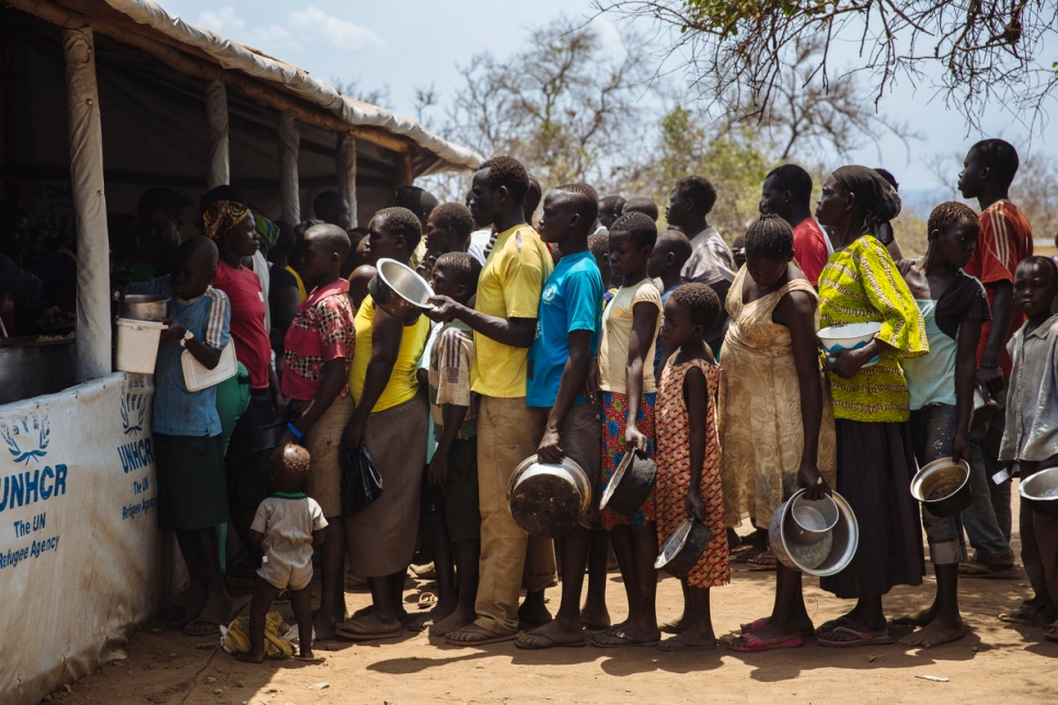 Uganda. South Sudanese refugees queue for food the Imvepi reception centre