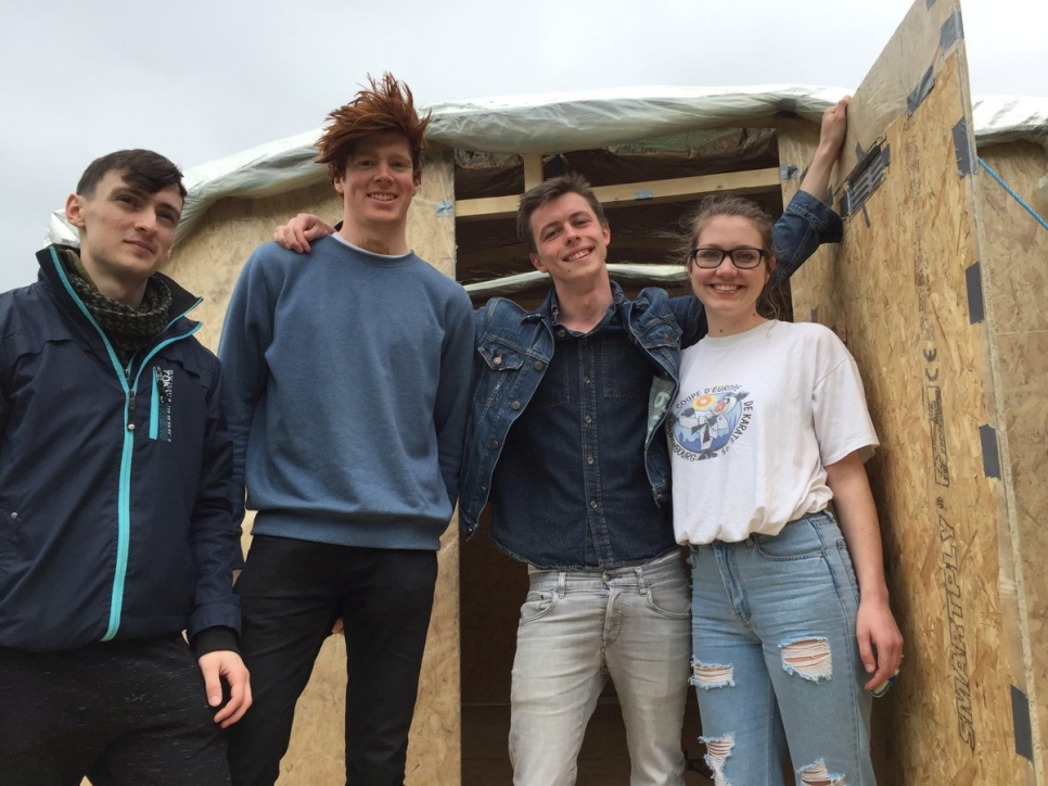 University College Cork civil engineering students show off a shelter with a raised platform that they designed and built