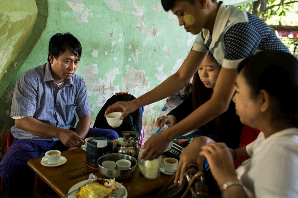 Thant drinks tea with his friends from work in Yangon, Myanmar.