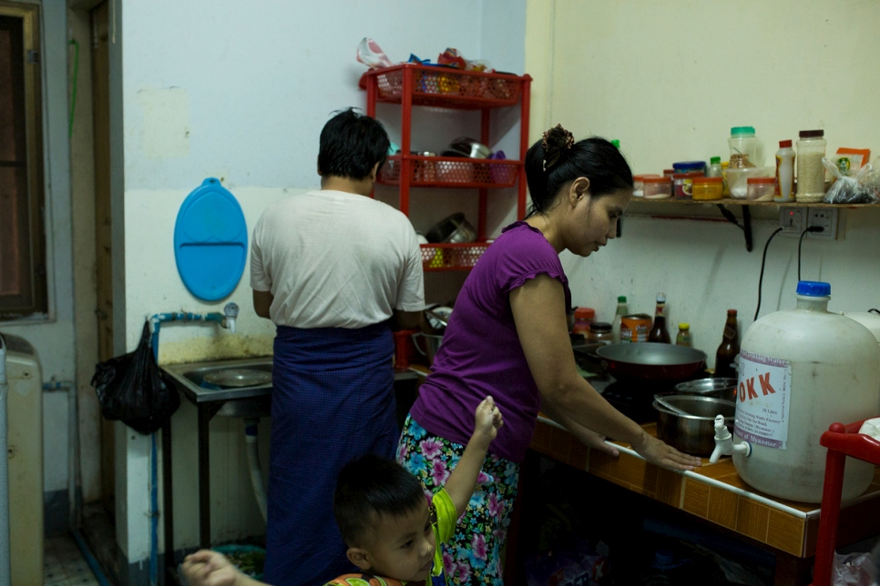 Thant and his wife, Ta Pyi Soe, 35, prepare dinner for their young sons in Myanmar.