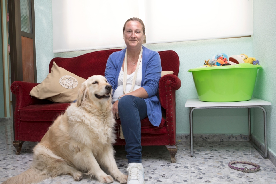 Elisa Salamanca, pictured with therapy dog Luna, heads CONECTA, a local non-profit connecting children with autism with their peers in the community.