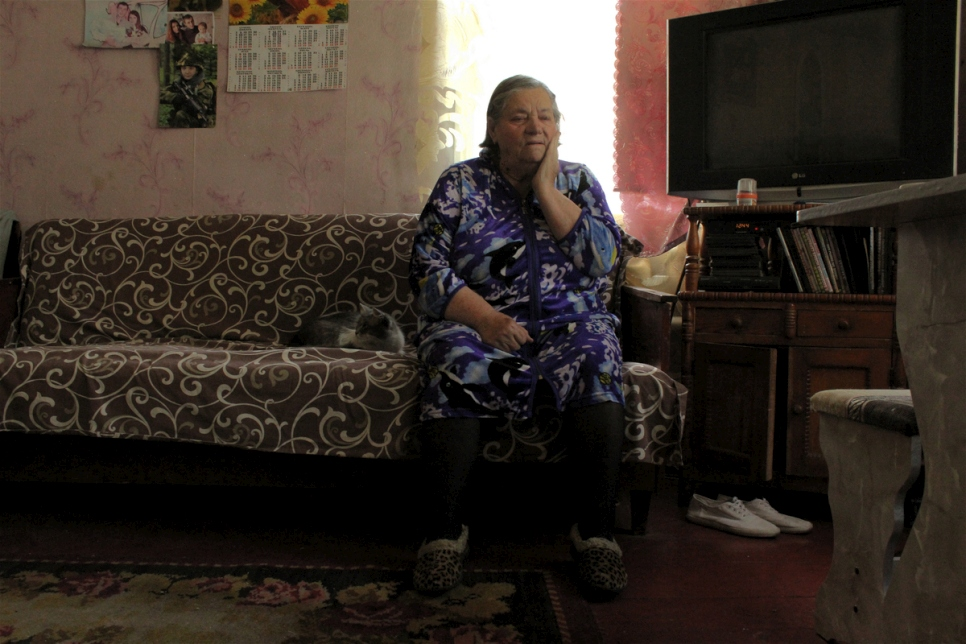Ukraine. Displaced elderly woman struggles to survive as the government suspends her pension