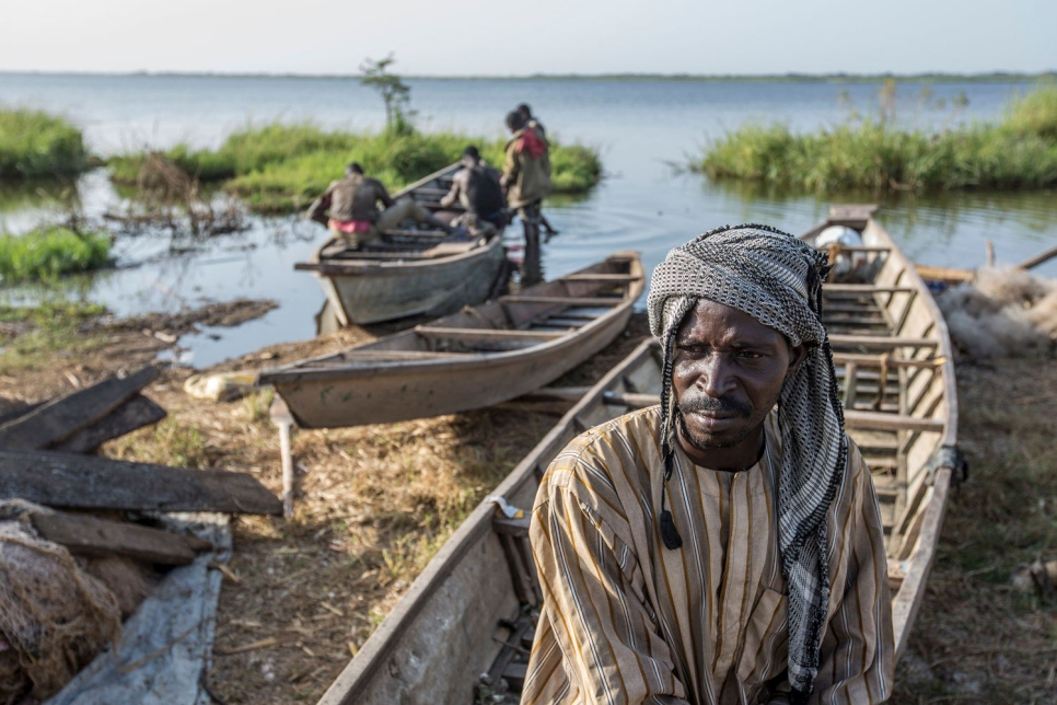 Hawali Oumar, 43, a refugee from Nigeria, fishing on the shores of Lake Chad. Hawali's father was killed by Boko Haram in his village, prompting Hawali to flee with his family to Chad.