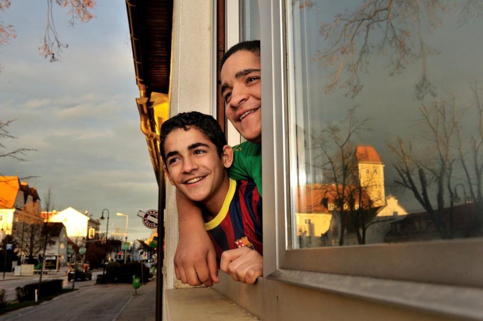 Austria. Syrian refugee kids looking out from their new home in a small town. They are on a resettlement program for Syrian refugees, in cooperation with UNHCR