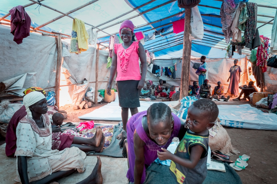 Sarah Katonga (Pink skirt) is an internally displaced woman from South Sudan, now living in a site for displaced people in Juba.
