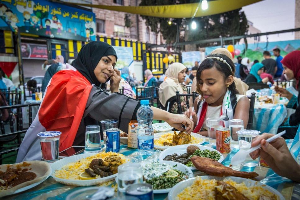 JORDAN. Refugees get together to break the Ramadan fast.