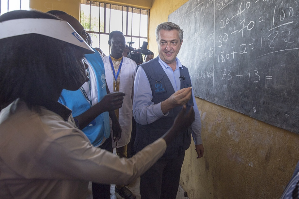 High Commissioner for Refugees Filippo Grandi chats to refugees in a classroom in Nguenyyiel Camp, Ethiopia.