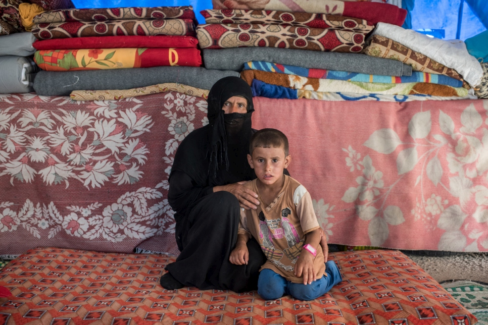 Shamsa Ali Bello, 46, and her son Mishan Salih, 6, in their tent.