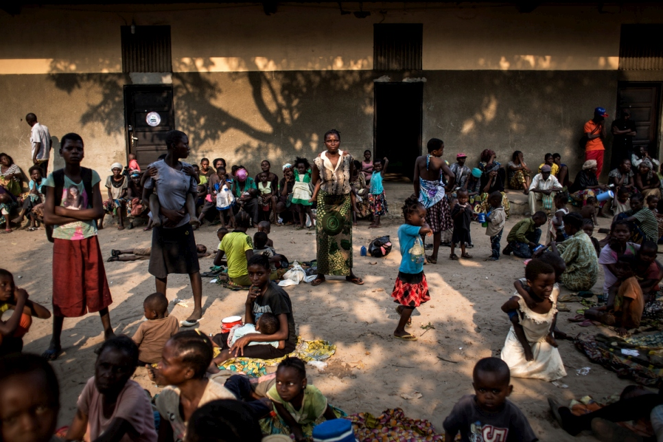 Women and children from Kasai Province take refuge in the grounds of a former clinic.