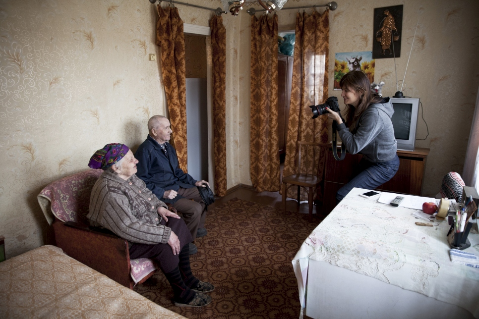 Helena photographs Lina, 78, and her husband Prokofiy, 86, in Slovyansk, eastern Ukraine. Their home was shelled in June 2014, forcing them to leave and move in with relatives. They have now been able to move back to their home following repair work by UNHCR and partners.