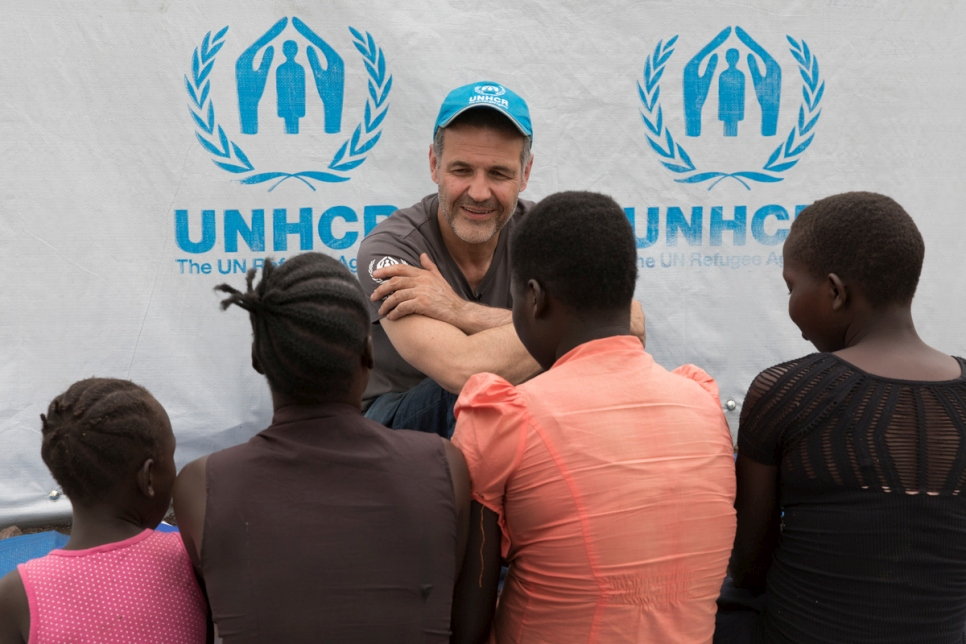 UNHCR Goodwill Ambassador Khaled Hosseini meets 18-year-old Gladys and her siblings and cousins in the Imvepi refugee settlement. For protection reasons their faces cannot be shown.