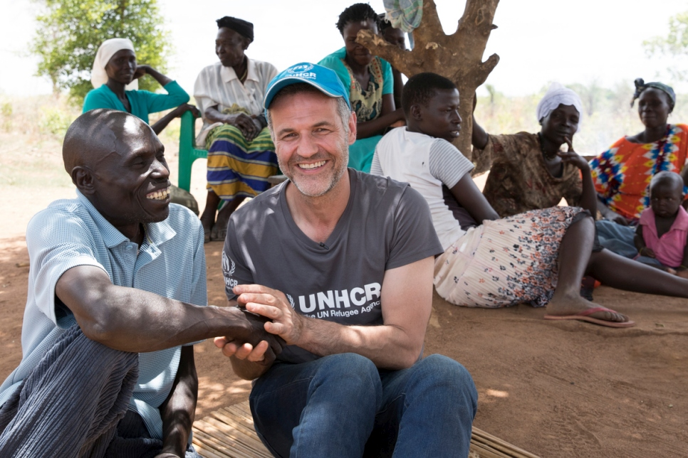 UNHCR Goodwill Ambassador Khaled Hosseini meets Ugandan farmer Yahaya Onduga in Bidibidi settlement. Yahaya is head of the Local Committee, which acts as a liaison between the host community and South Sudanese refugees.