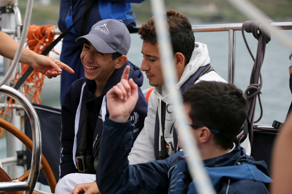 Teenagers enjoy a moment aboard the Spirit of Oysterhaven.