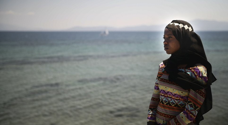 Emi looks out over the sea towards Turkey. Over one million refugees crossed the Mediterranean Sea in the year preceding Emi's visit.