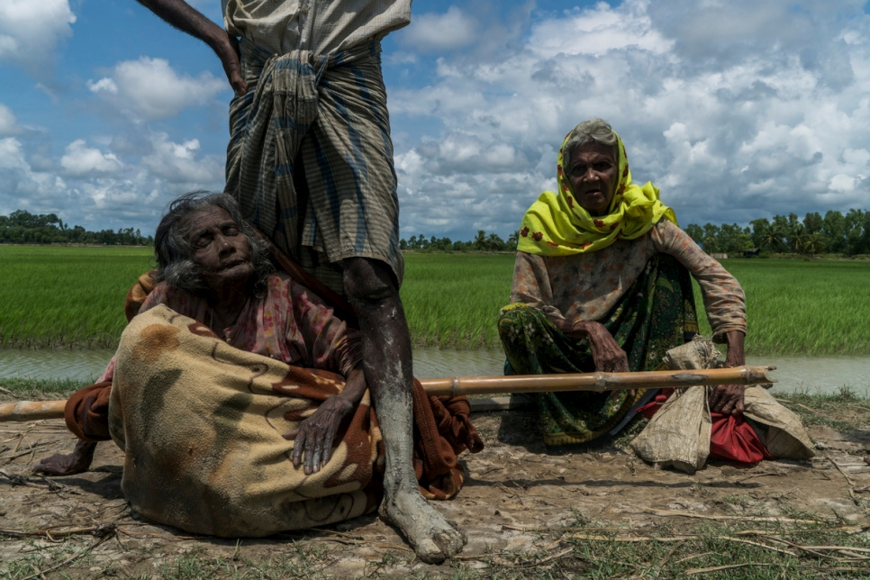 Bangladesh. An elderly Rohingya refugee is carried across the border