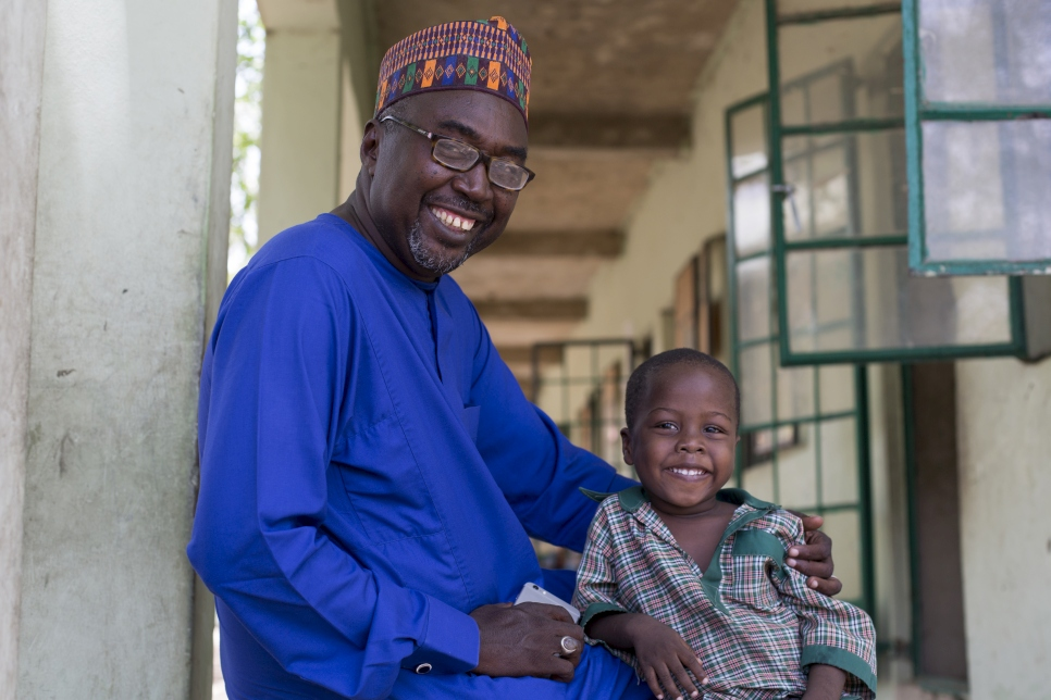 Mr Mustapha and his son who is enrolled in a nursery class at the school. Future Prowess Islamic Foundation School (I), Maiduguri, Borno State, Nigeria.