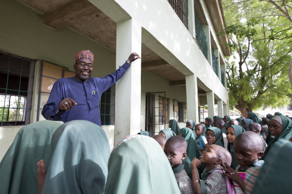 Mr Mustapha and the students of Future Prowess Islamic Foundation School at a morning assembly. Future Prowess Islamic Foundation School (I), Maiduguri, Borno State, Nigeria.