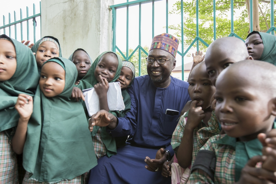 Mr Mustapha and the students of Future Prowess Islamic Foundation School before morning assembly, Future Prowess Islamic Foundation School (I), Maiduguri, Borno State, Nigeria.