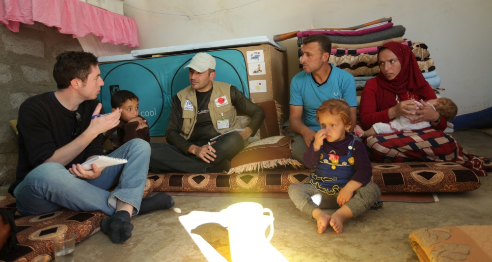 Michael and a member of a UNHCR partner organization interview a family who have benefited from UNHCR's legal assistance activities at a camp for internally displaced Iraqis in the Kurdistan Region of Iraq