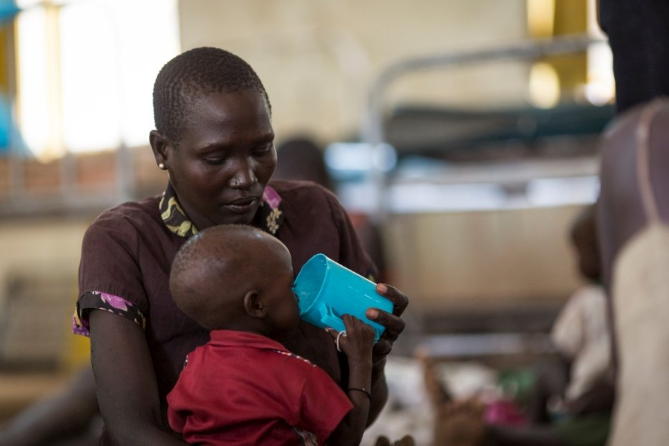 A refugee from South Sudan feeds her child at the stabilization centre in the Kakuma Refugee Camp Hospital, Kenya.