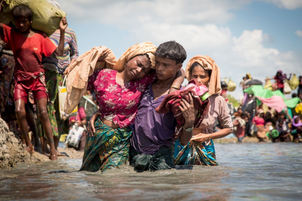 Thousands of newly arrived Rohingya refugees cross the border near Anzuman Para village, Palong Khali, Bangladesh.