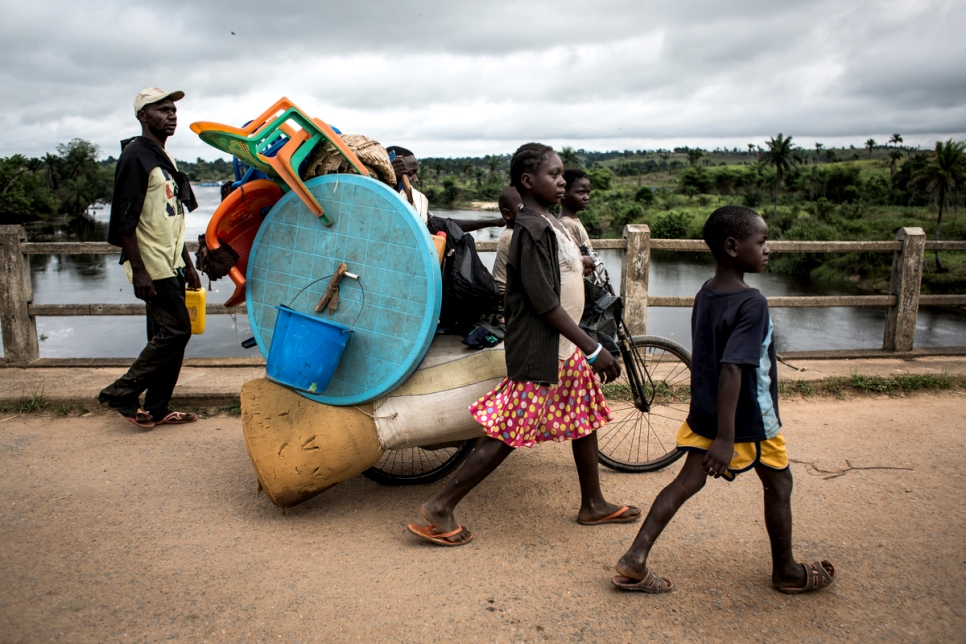 Democratic Republic of Congo. A family of Internally displaced persons are seen on the road whilst fleeing to kananga.