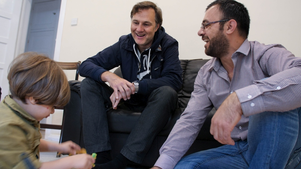 Actor and UNHCR Goodwill Ambassador David Morrissey meets a Syrian family in London, UK