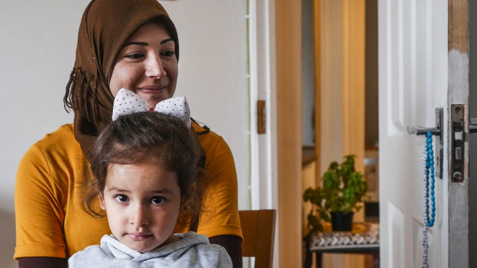 """I was very happy when I came here. It felt like home."" Hiba and her daughter at their new home in London."