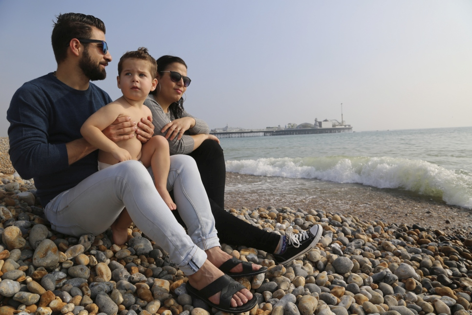 """We left Syria as it was not a safe place for us to be."" Nehad, Merry, and their son, resettled under the VPRS scheme, enjoy a day on Brighton beach"