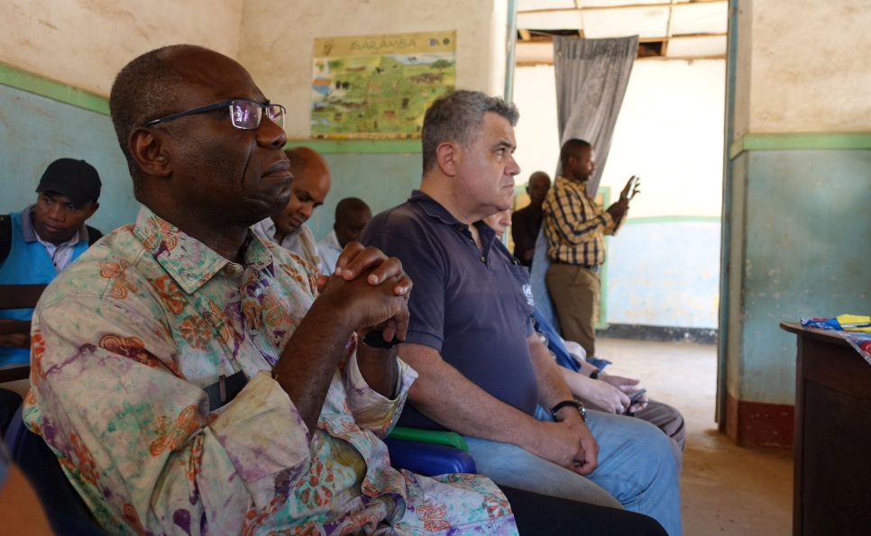 Noah* shares his shelter concerns with Mr. Akodjenou during his visit to Meri refugee site.