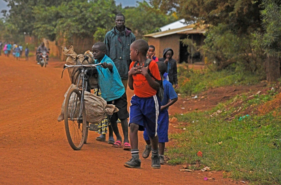 Uganda. Young refugee pupils walk to school in Kyangwali refugee settlement in Hoima District