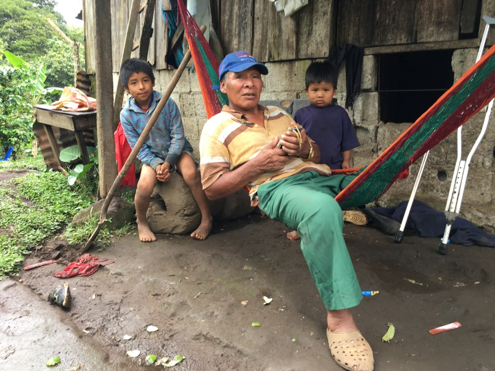 Head of the family Don Martin Andrade lies in a hammock at the farm where his family live and work in the highlands of southeast Costa Rica. He is flanked by Moises (left) and and Pablo (right).