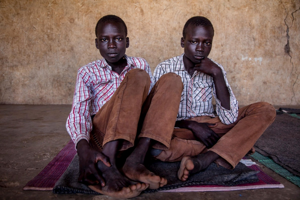 Kenya. South Sudan refugee twins Jacob and Simon, 14 in Kakuma Refugee Settlement