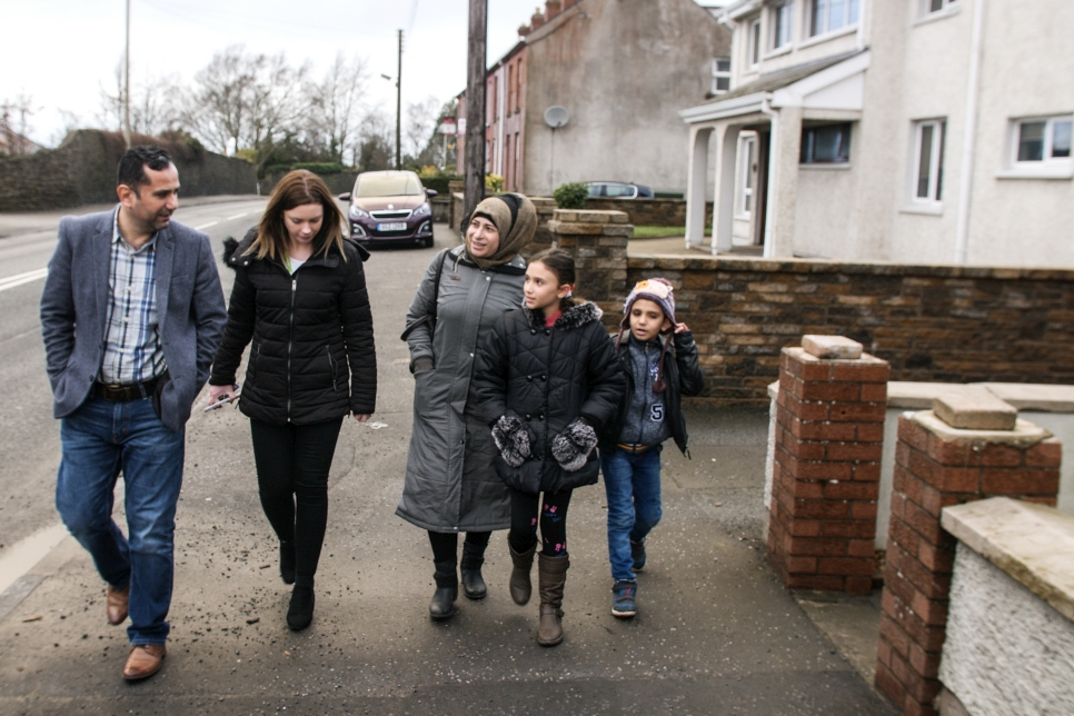 Maisaa and her two children, Esraa and Yahya, are shown around the town of Armagh in Northern Ireland.