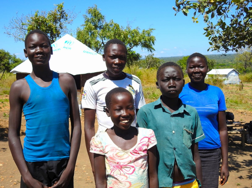Uganda. South Sudanese refugee teenager takes care of younger siblings