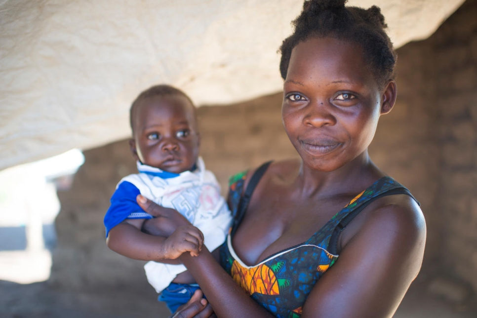 Chorty Tabo, 25, holds her son, Simon. She fled South Sudan a year ago. She is part of a women's association, working together in a hair salon in Meri refugee site in the DRC.